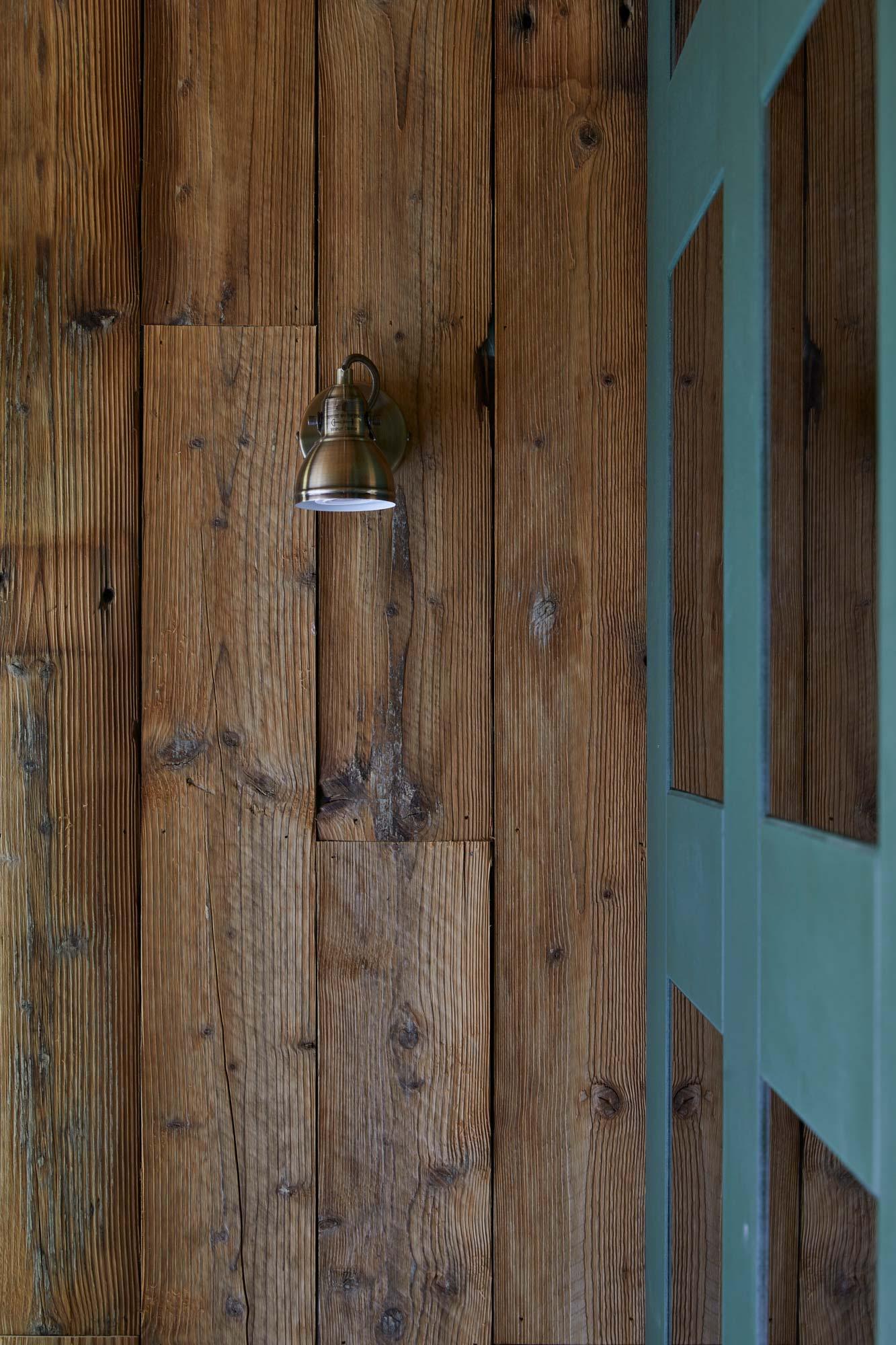 Bedroom spotlight on reclaimed pine cladding