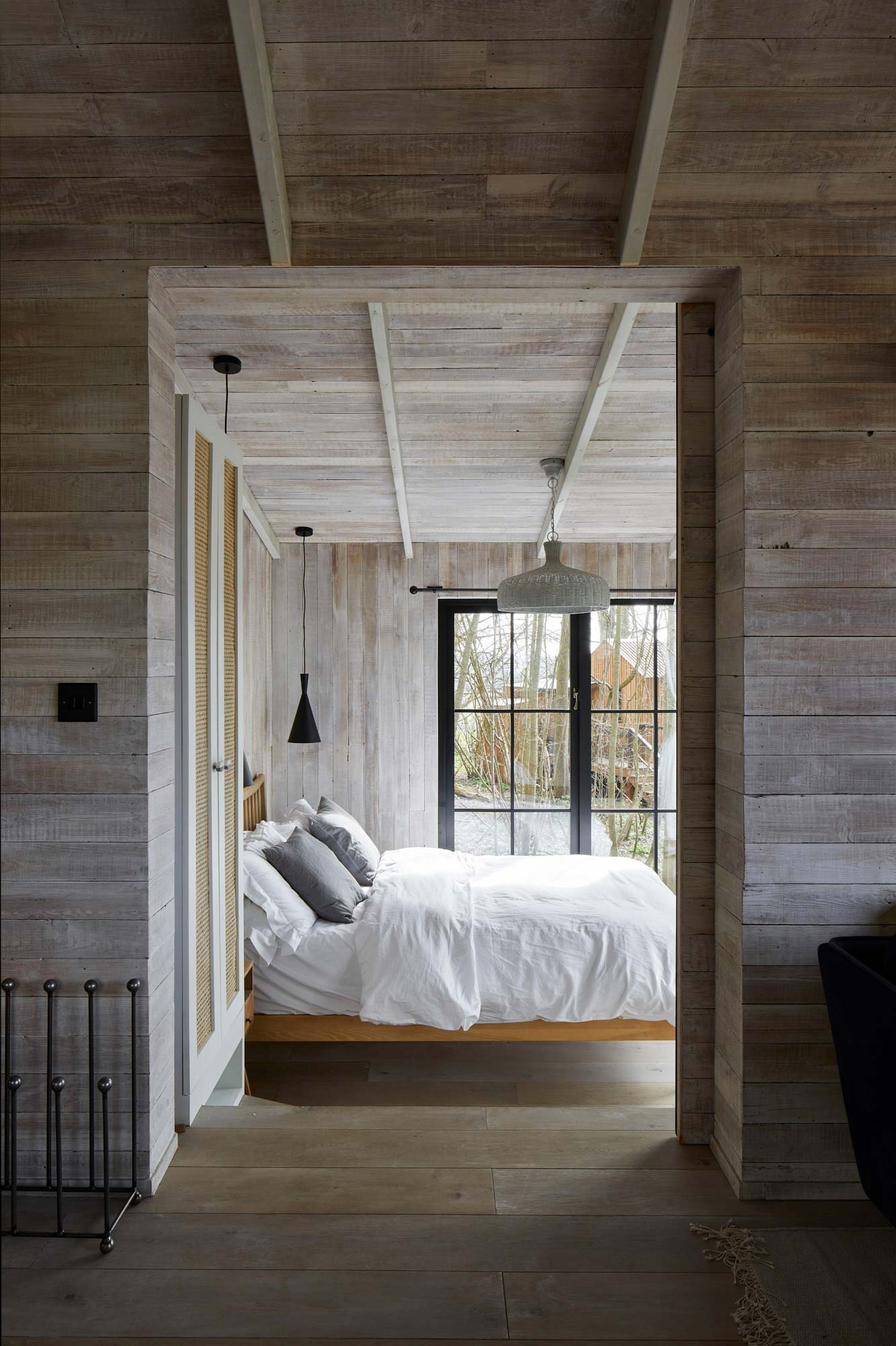 Treehouse bedroom with white cladded walls