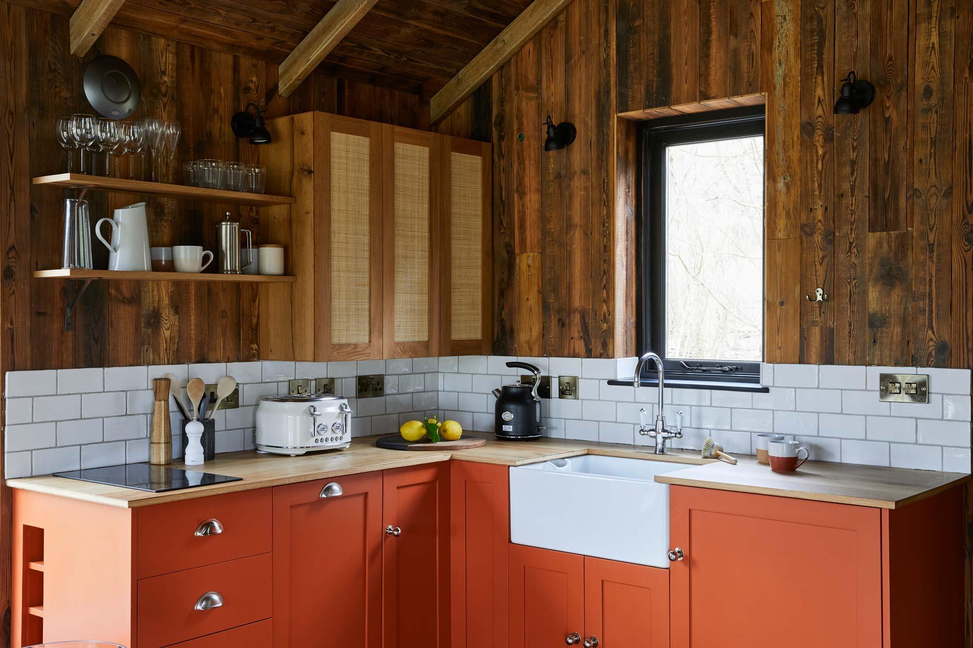 Bespoke orange kitchen in treehouse