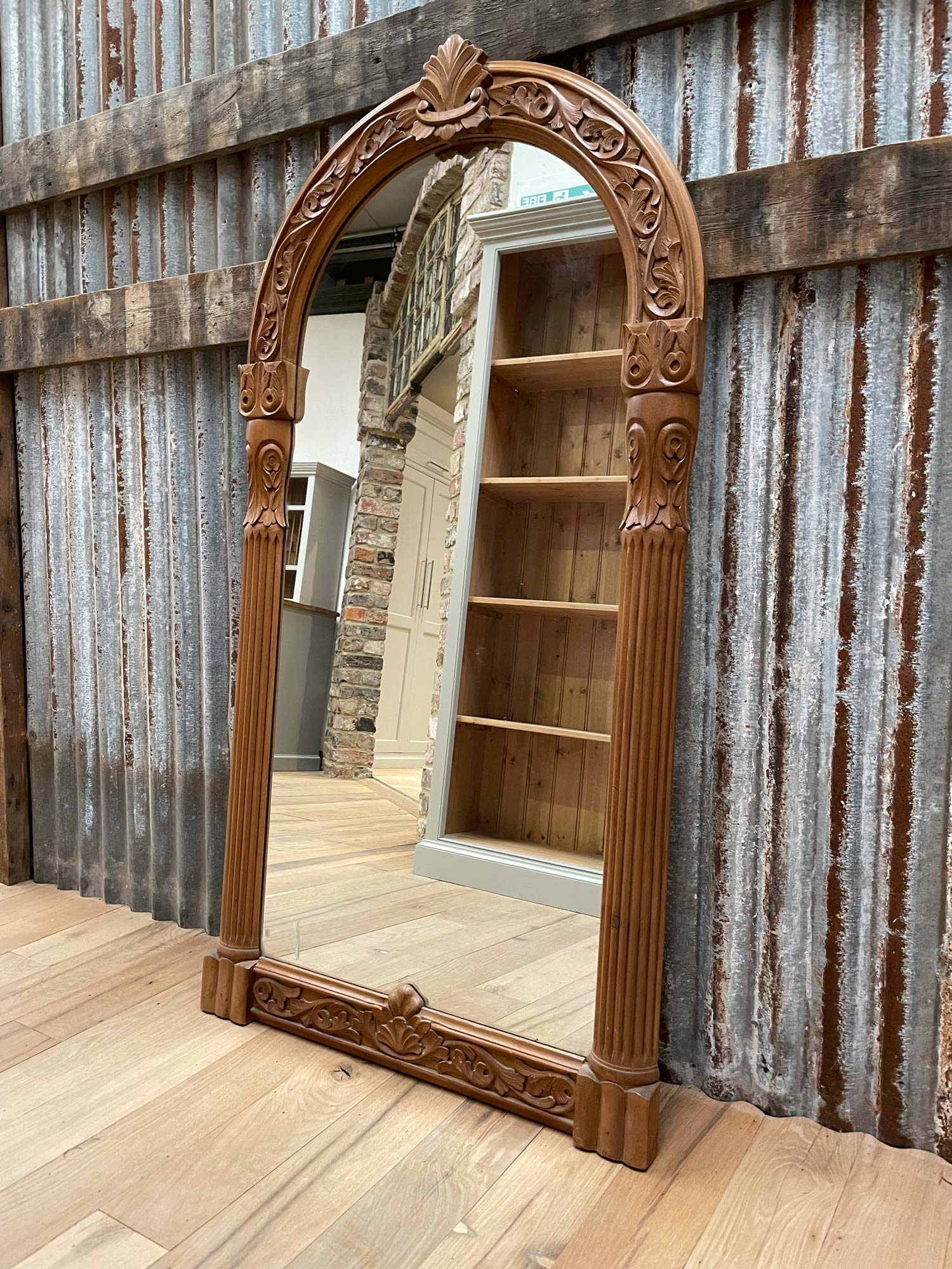 Mirror with carved pine frame