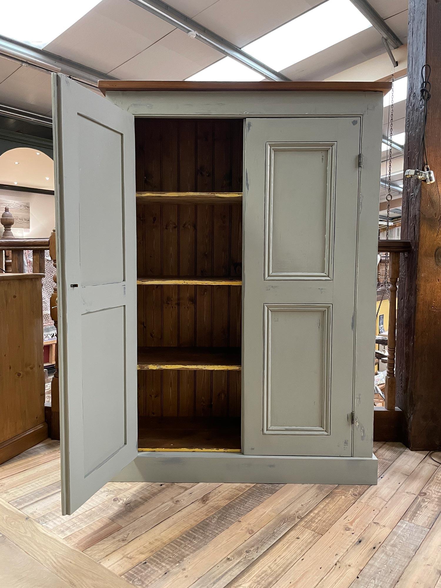 Door open on antique storage cabinet