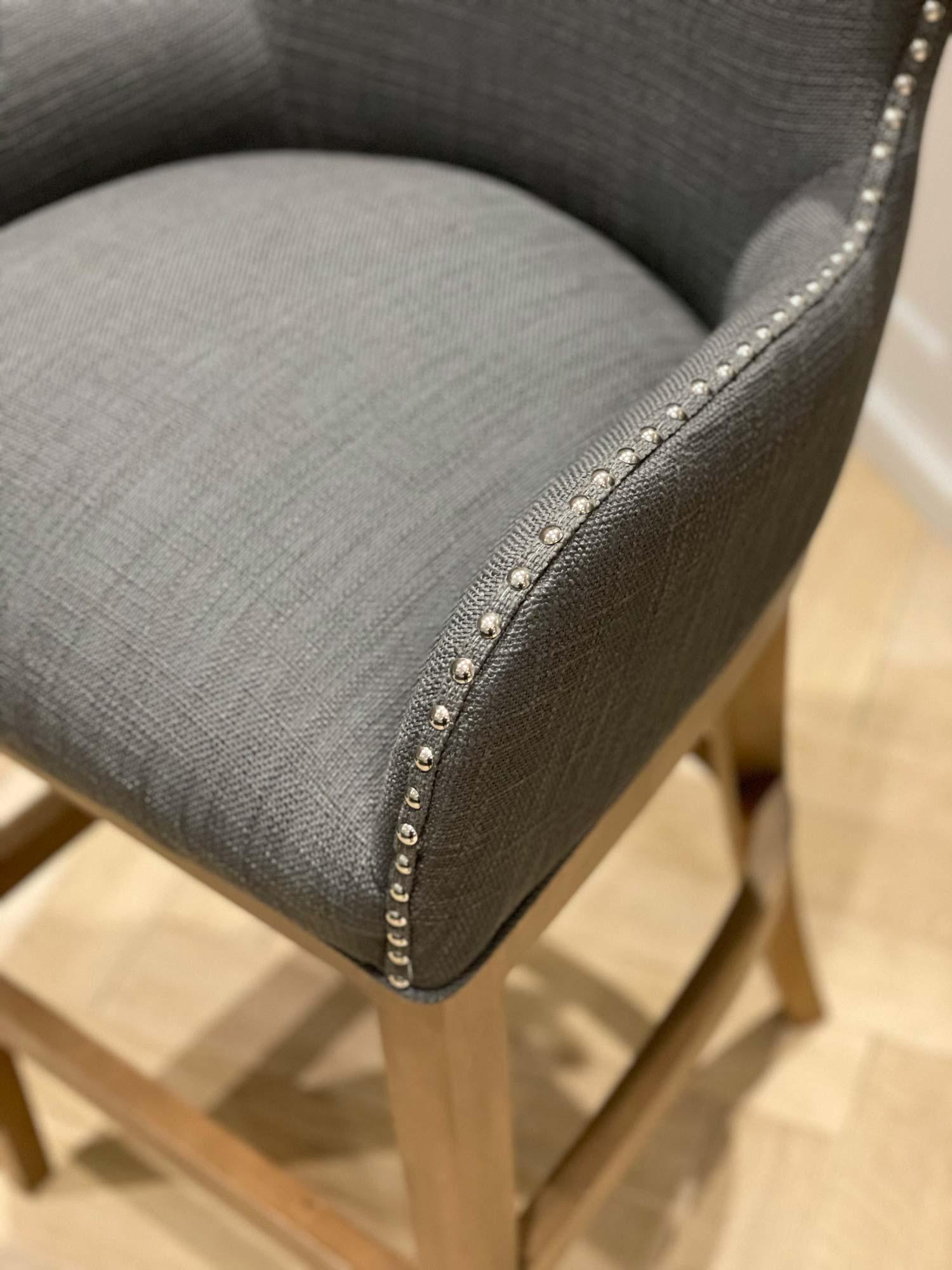grey upholstered bar stool