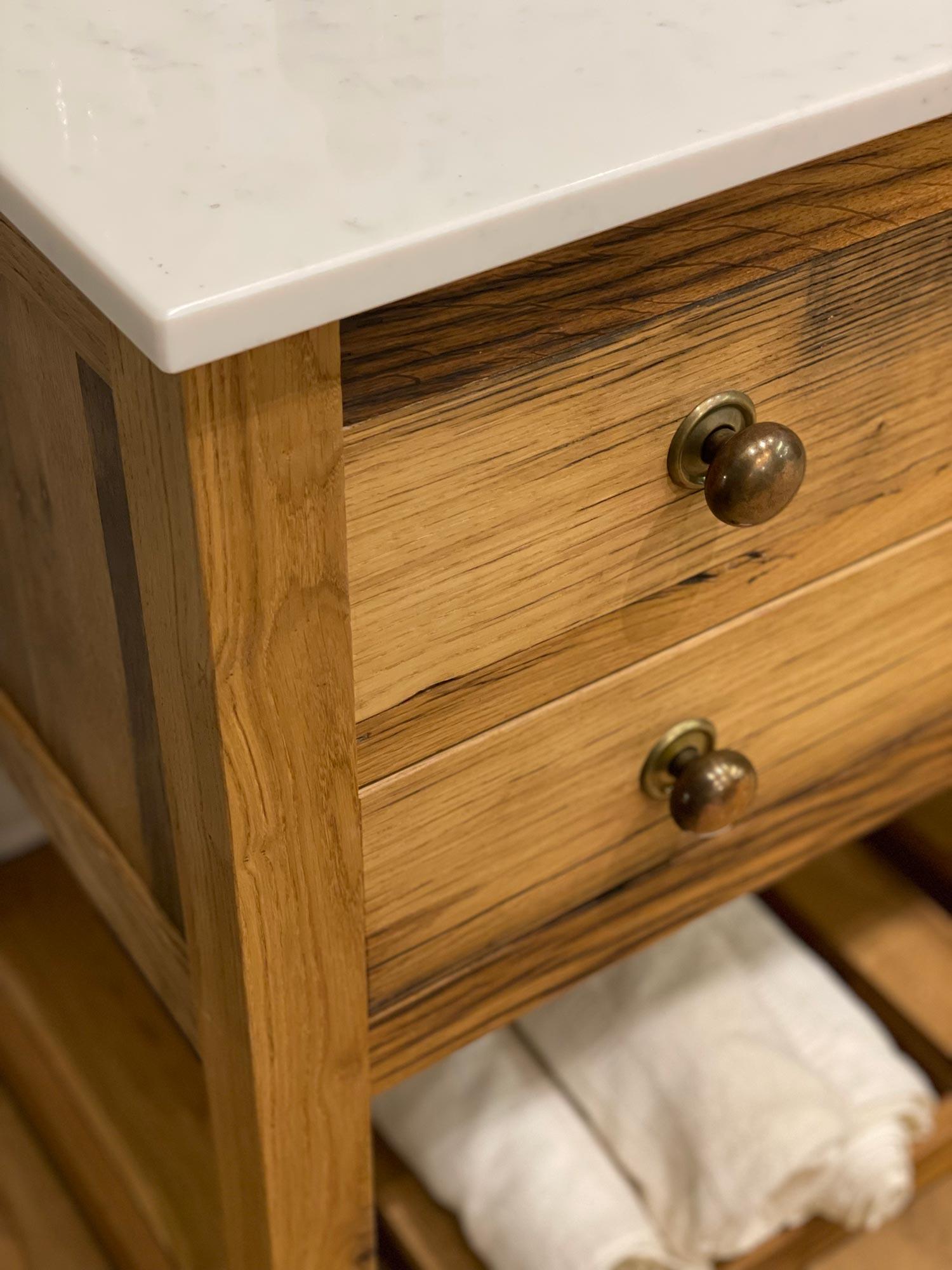 Burnt brass knobs on vanity unit