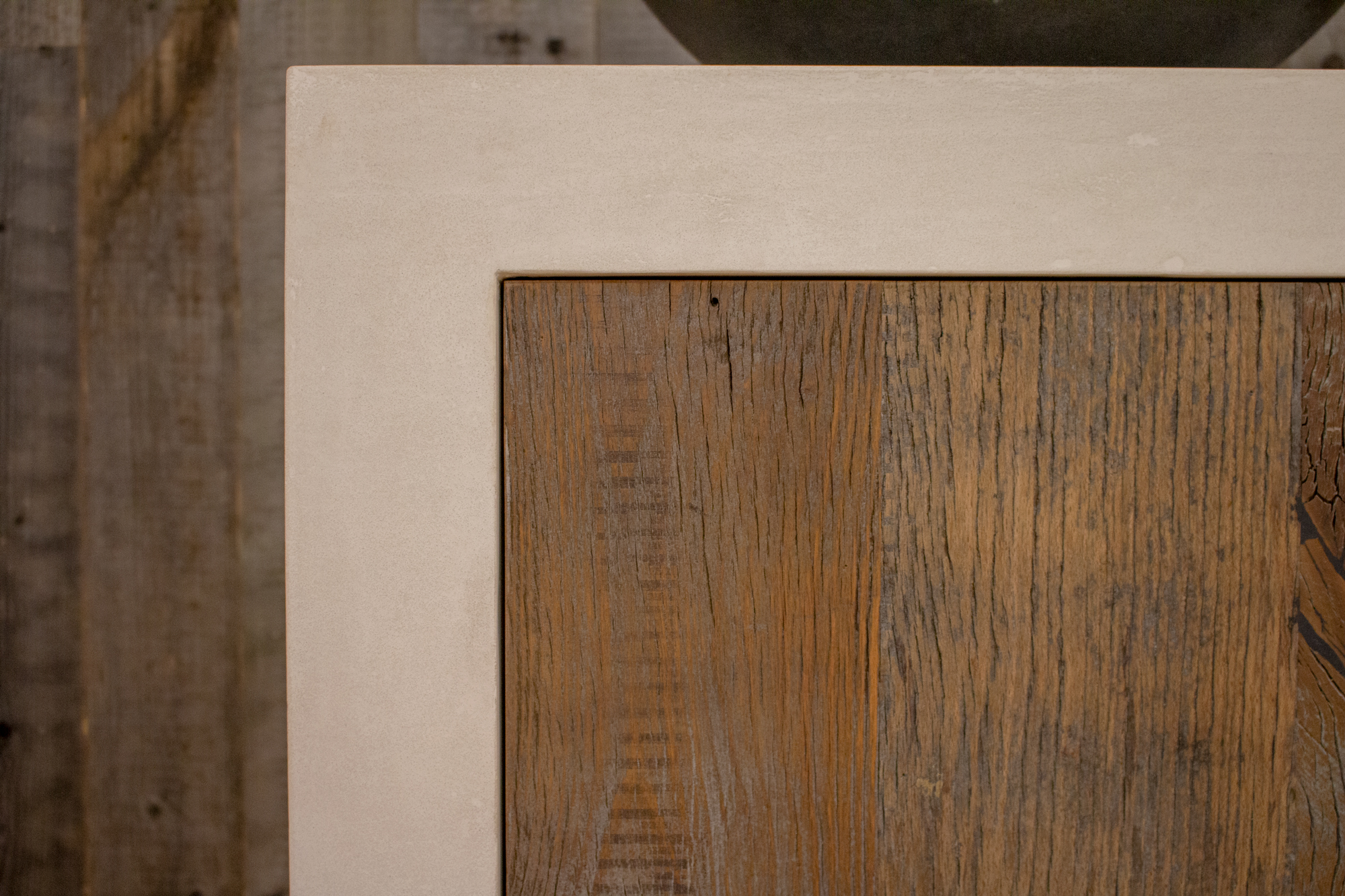 Concrete kitchen unit with reclaimed wood door