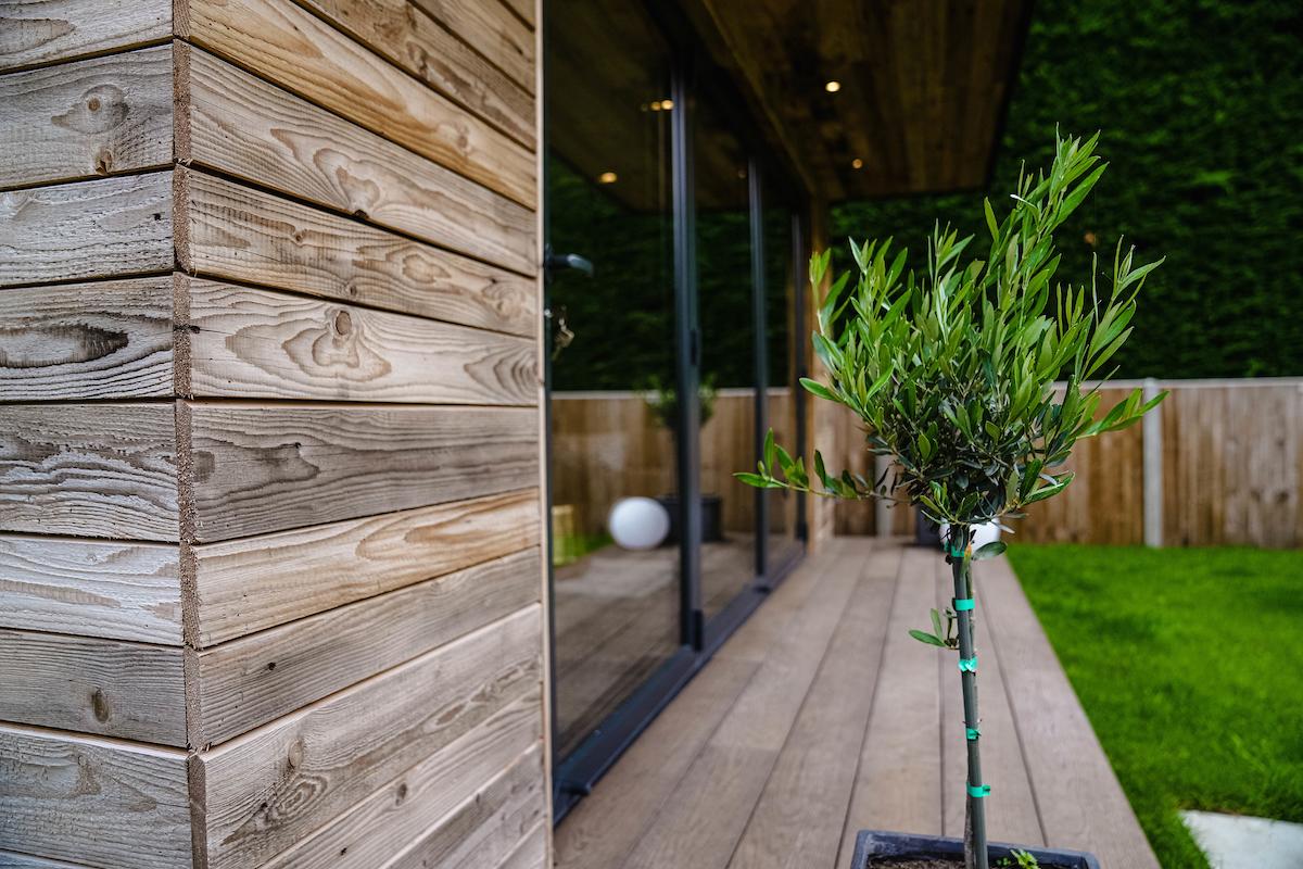 Garden room reclaimed cladding