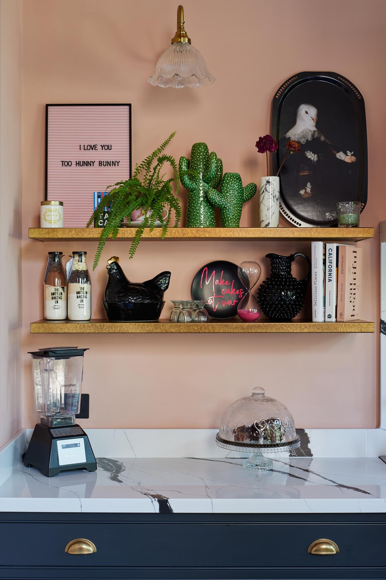 Floating brass kitchen shelves