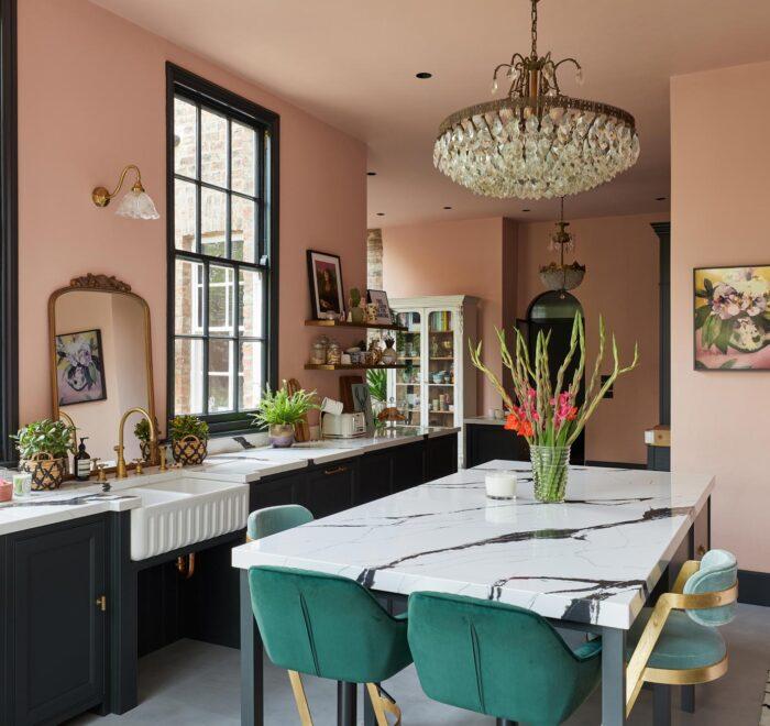 Bespoke kitchen island with green bar stools