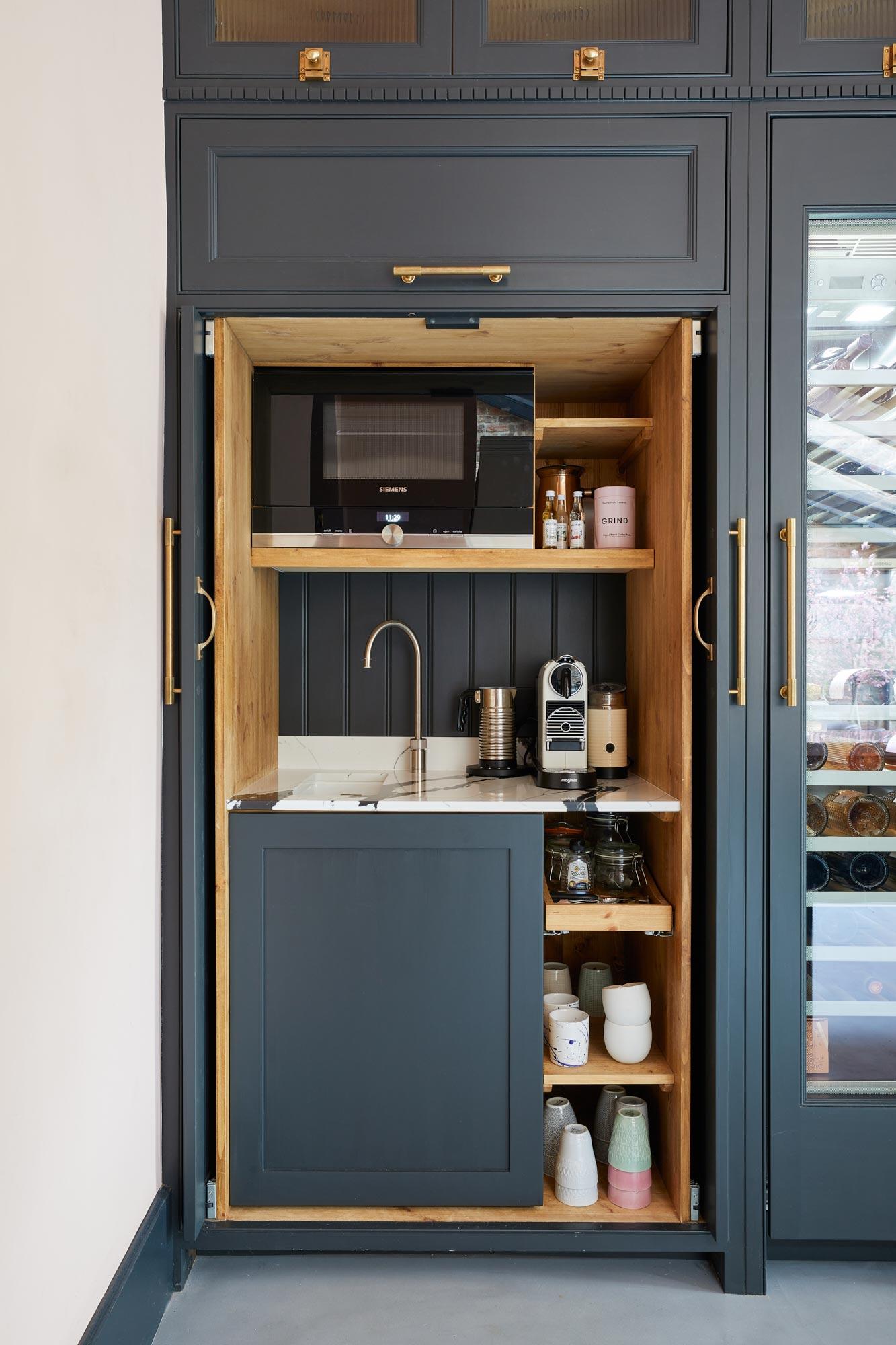 Pocket doors in kitchen cabinet